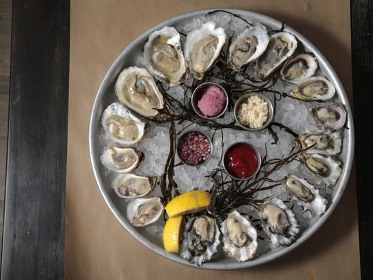 A platter of oysters, featuring Calm Cove, Kusshi,