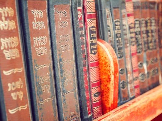 Vintage old religious books on a shelf, Jerusalem, Israel