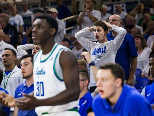An FGCU Eagles fan is shocked by a referee's call during