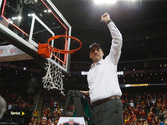 Iowa State coach Steve Prohm holds up a piece of the net after winning the 2017 Big 12 Conference Championship at the Sprint Center in Kansas City, Mo.