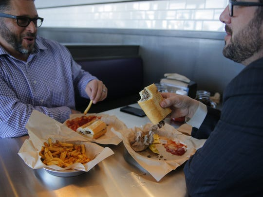 Joey Belicha (left) eats at Boardwalk Sub Shop Monday afternoon with Josh Jorn (right).
