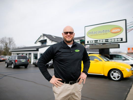 General manager Jason Meier stands out front of car dealership he and his father own and operate in Middletown, Ohio, on Monday, March 5, 2018.