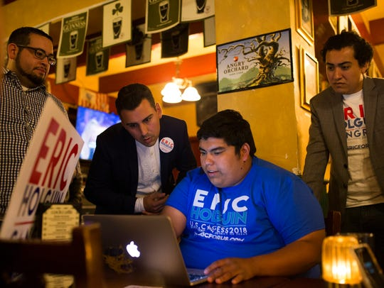 Eric Holguin (second from the left), a Democratic candidate