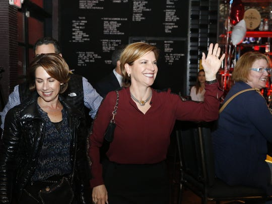 Congressional candidate Dori Fenenbock waves to supporters at her election party at Cantina Malolam in West El Paso Tuesday.