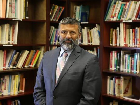 Chacku Mathai, president and CEO of the Mental Health Association, in the library at the 320 North Goodman St. center in Rochester.