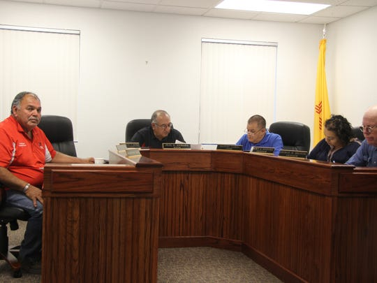 Members of the Loving Village Council discuss village business during a special meeting, March 2, at Loving City Hall.
