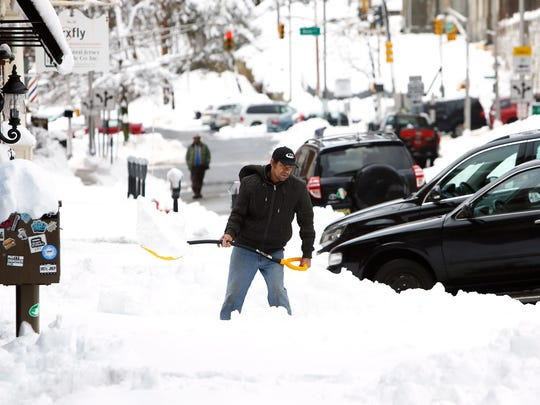 Residents and business owners in Morristown dig out the morning after a nor'easter dumped over a foot and a half of snow around Morris County. March 8, 2018.  Morristown, NJ.