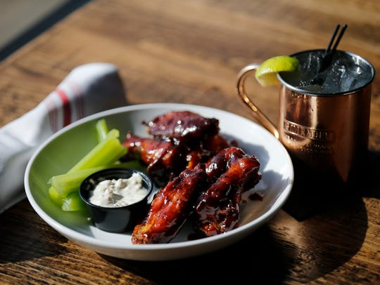 An order of rotisserie wings and a Moscow Mule at Revolution