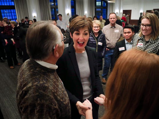 Gov. Kim Reynolds greets the crowd during a rally at the Tea Room in Des Moines, on Friday, March 9, 2018.