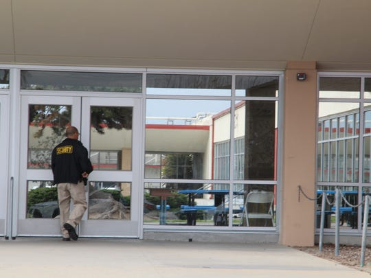 A security guard walks into North Salinas High School