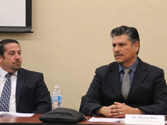 Salinas Union High School District Superintendent Dan Burns, left, and Alisal Union School District Superintendent Hector Rico, right, sit together at a meeting.