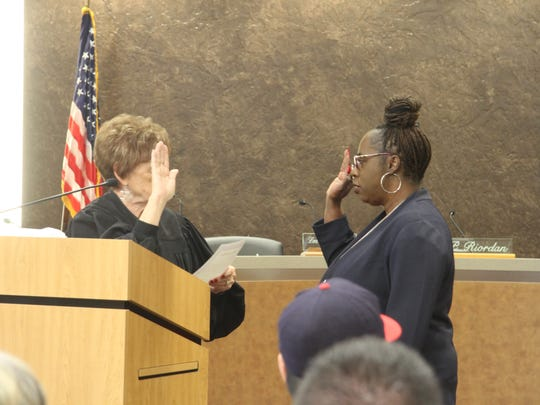 Newly elected Municipal Judge Collis Johnson recites the oath of office Monday, March 12, 2018.