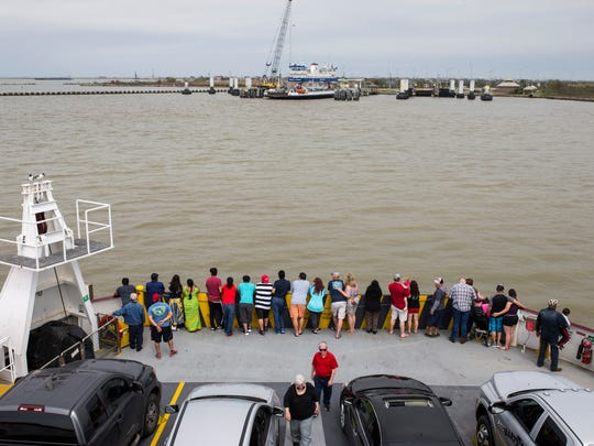 People watch as their ferry approaches Bolivar Peninsula on Saturday, March. 10, 2018. The area was devastated when Hurricane Ike hit the peninsula in 2008.