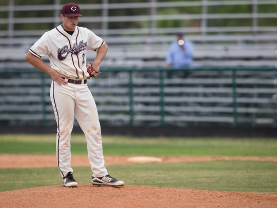 Calallen's Brandon Broughton stands on the pitchers
