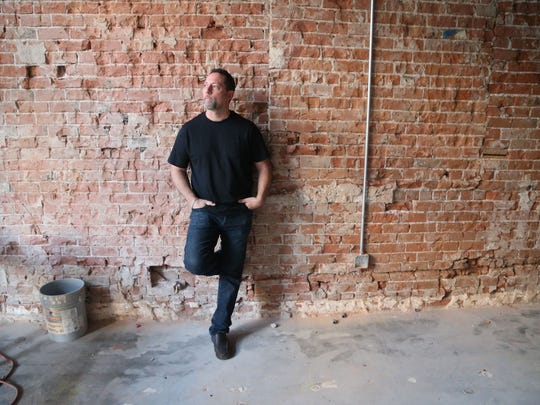 Damian Serafine stands in the location he was renovating for his shop Serafina that now occupies the space.