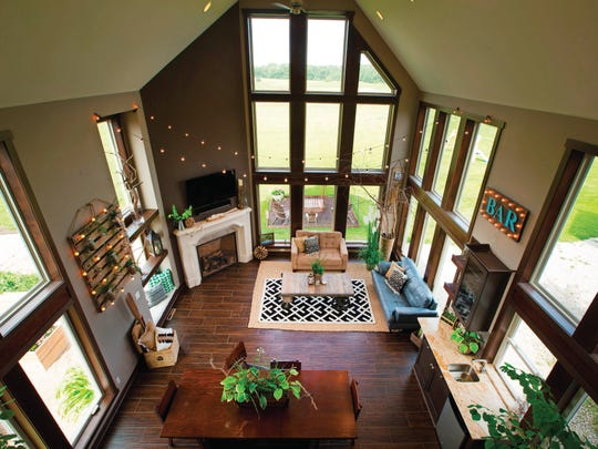 The Lawrences' large sunroom reflects their casual