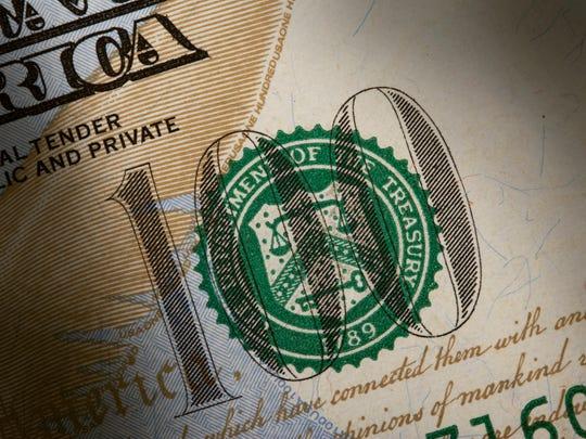 Detail of a $100 bill.