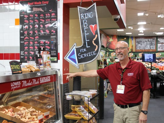 Steve Lenzo checks the meat counter's service bell