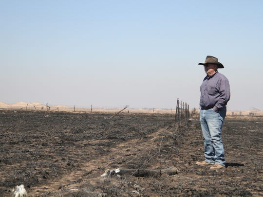 Greg Gardiner overlooks his fire-ravaged ranch following devastating wildfires, in Clark County, KS. The amount of moisture received across the United States' southern high plains since October has been ridiculously low, and forecasters warned Friday, March 16, 2018, that the intensifying drought has resulted in critical fire danger and some winter wheat crops being reduced to stubble across several states.