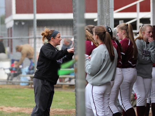 Owen head coach Angela Louis, in her first season with the team, talks to the Warlassies between innings during a 5-0 victory over Avery.