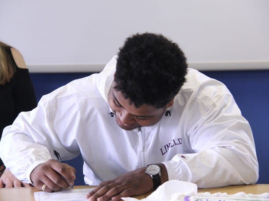 Blanchet senior Martin Sylvester signs to continue his college football career at Llinfield