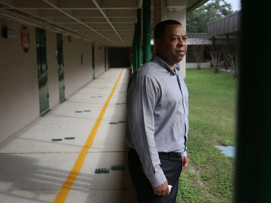 "Riley Elementary Principal Karwynn Paul, shown in this Jan. 2017 photo taken after the school was vandalized, has resigned after being placed on leave   in January 2018 for ""misconduct"" allegations."