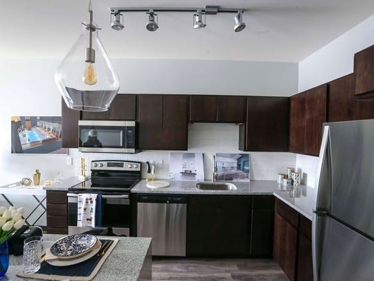 A kitchen in model apartment is seen during tour of