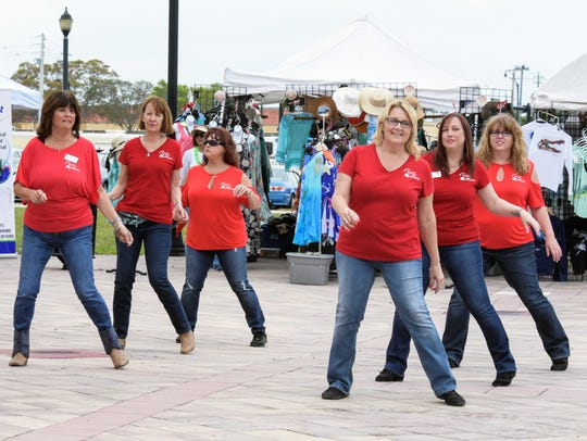 Members of the Wild Roses Dance Team entertain the