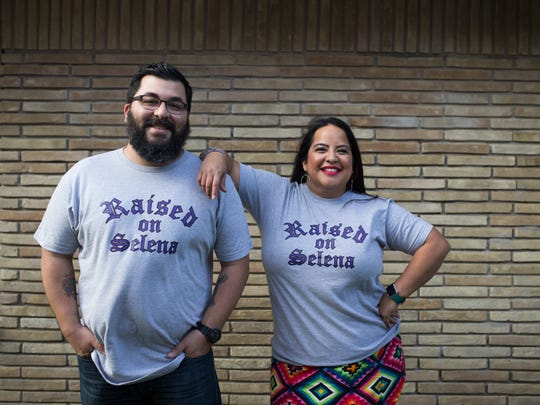 Elena Flores (right) and Gerald Flores pose for a photo during the Tejano Justice League's Selena-themed dinner on Thursday, March 22, 2018.