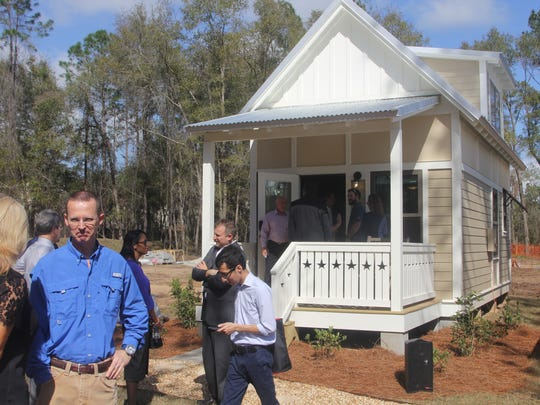 City Commissioners and officials were given a tour of the first house within The Dwellings, a tiny house community built by Kearney.