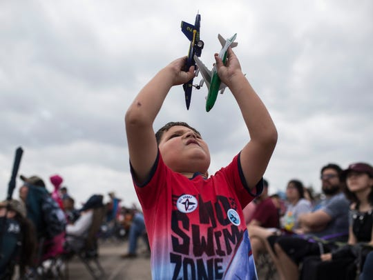 Kyle Gaytan (4) plays with his toy air planes during the Wings Over South Texas on Saturday, March 24, 2018, Naval Air Station Kingsville.