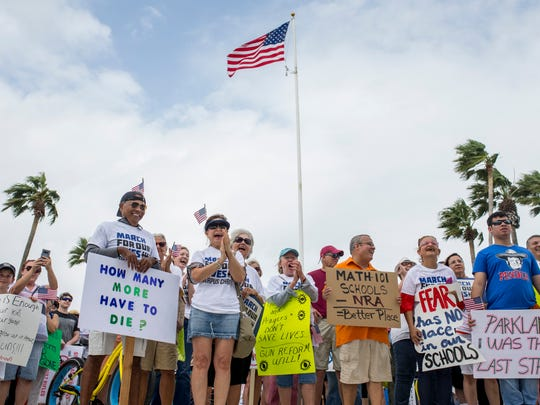 People cheer as speakers talk about ending gun violence  during the March for Our Lives rally on Saturday, March 24, 2018 at Sherrill park in Corpus Christi.