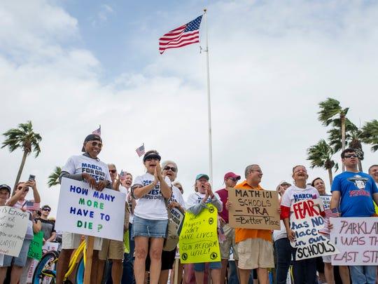 People cheer as speakers talk about ending gun violence