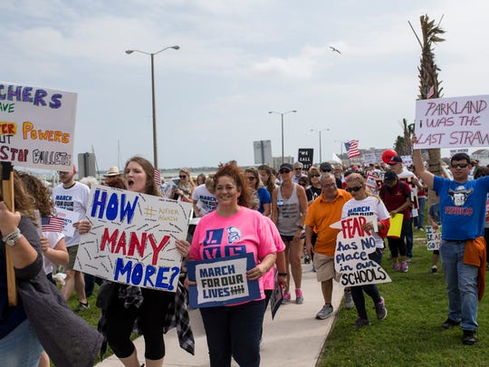 People march down Shoreline Boulevard during the March for Our Lives rally on Saturday, March 24, 2018 in Corpus Christi.
