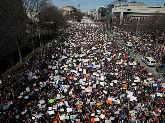 Looking west, people fill Pennsylvania Avenue during