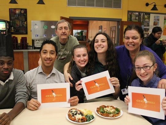 The winning team is pictured with their appetizer and