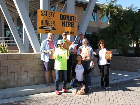 Volunteers gather to accept donations for Satisfy the Hunger on Friday, March 23, 2018, at the Naples Daily News office in North Naples.