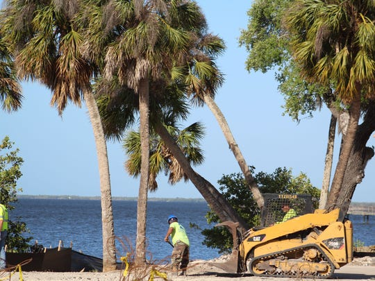 Demolition crew works along Charlotte Harbor in Port