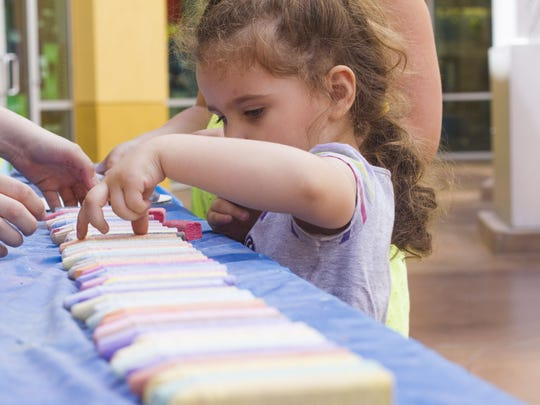 Go ahead, let kids color on the pavement. Artists will be joining them at the Chalk Art Festival.