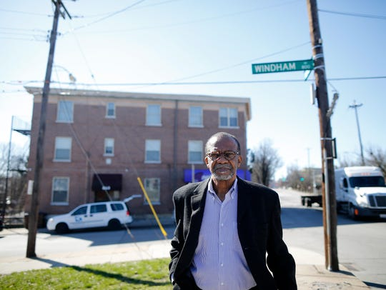 Jim King, 72, the executive director of the Avondale Redevelopment Corp. from 1980 through 2005, walks north on Reading Road, past the first building the organization developed, its office space, on the corner of Reading and Windham Avenue. In the late 1990s, King's group developed the Urban League building next door.