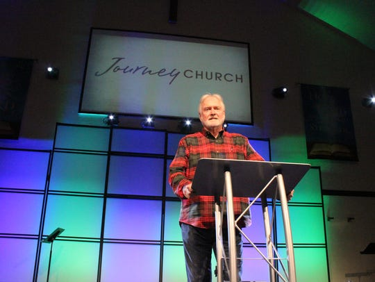 Pastor James Greer stands at his pulpit at Journey Church in Pineville. The fast-growing church has a security team that practices annually through training courses and exercises at the campus.