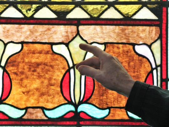 Sexton Carroll Neidhardt points to one of the church's
