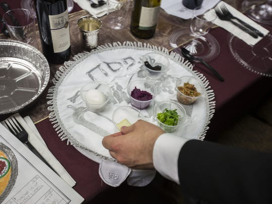 Yehoshua Bedrick sets up a seder plate before Passover at Chabad of Scottsdale on April 22, 2016 in Scottsdale, Arizona.