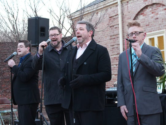 Southern gospel music group GloryWay Quartet performs during the 61st annual Easter Sunrise Service at Kingwood Center Gardens on Sunday, April 1, 2018. The group includes (from left to right) tenor Bryan Langley, lead/baritone manager Justin Crank, baritone John Cole and bass Justin Sayger.