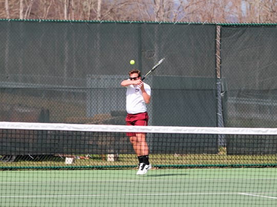 In a battle of number one seeds, Owen senior Joseph Frith follows through on a powerful forehand against Avery's Charles Roberson. Frith won, 10-5.