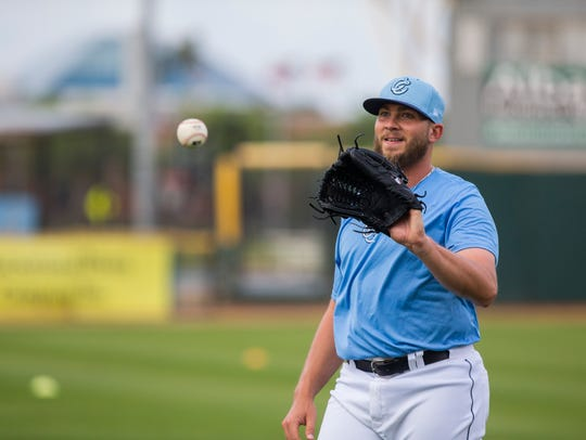 Hooks' pitcher Riley Ferrell warms up during the Hooks