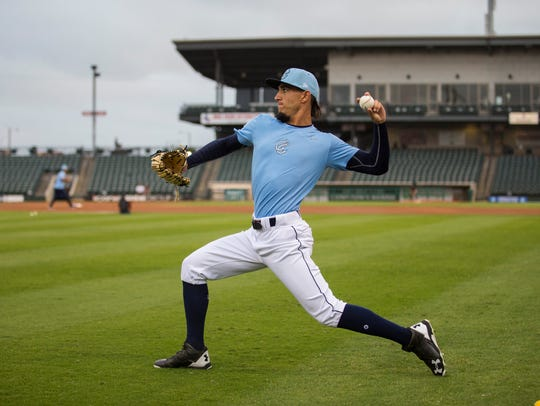 Hooks' pitcher Cionel Perez warms up during the Hooks