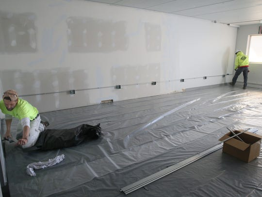 Contractors work on the practice space being created