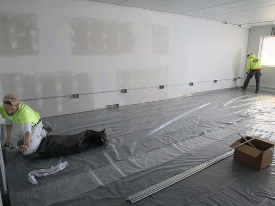 Contractors work on the practice space being created for the Milwaukee Bucks new NBA 2K gaming team.