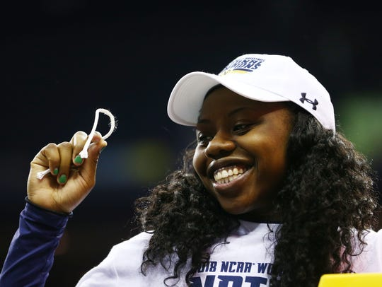 Notre Dame Fighting Irish guard Arike Ogunbowale (24) holds a piece of the net as she helps cut down the net after defeating the Mississippi State Lady Bulldogs in the championship game of the women's Final Four in the 2018 NCAA Tournament at Nationwide Arena. Notre Dame won 61-58.